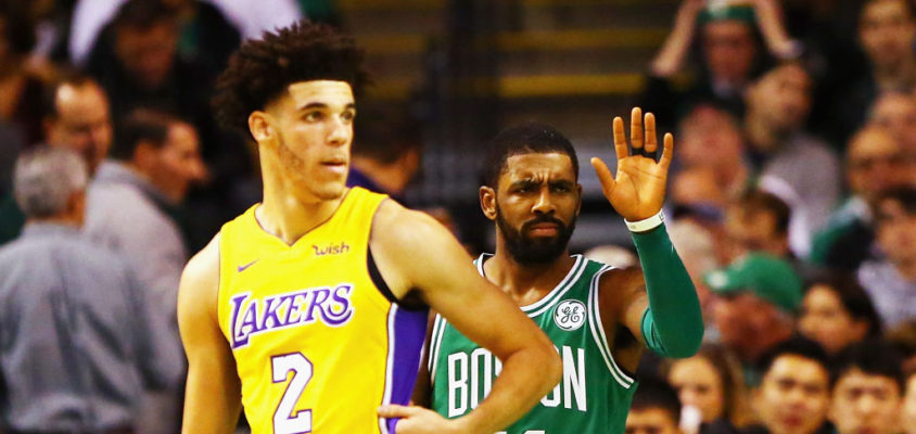 BOSTON, MA - NOVEMBER 08: Lonzo Ball #2 of the Los Angeles Lakers and Kyrie Irving #11 of the Boston Celtics react during the first quarter of their game at TD Garden on November 8, 2017 in Boston, Massachusetts.