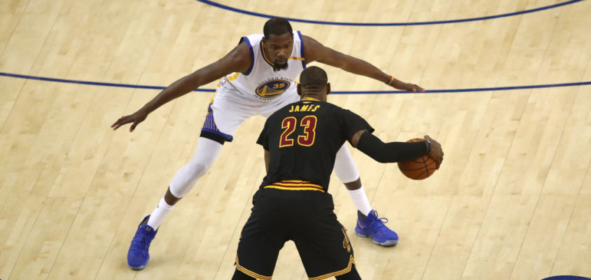 OAKLAND, CA - JUNE 12: LeBron James #23 of the Cleveland Cavaliers is defended by Kevin Durant #35 of the Golden State Warriors during the first half in Game 5 of the 2017 NBA Finals at ORACLE Arena on June 12, 2017 in Oakland, California