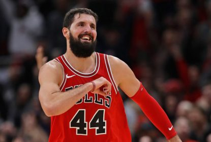 CHICAGO, IL - DECEMBER 18: Nikola Mirotic #44 of the Chicago Bulls celebrates as he runs down the court after hitting a 3 point shot late in the game against the Philadelphia 76ers at the United Center on December 18, 2017 in Chicago, Illinois. The Bulls defeated the 76ers 117-115