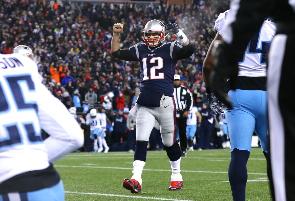 FOXBOROUGH, MA - JANUARY 13: Tom Brady #12 of the New England Patriots reacts after a touchdown in the second quarter of the AFC Divisional Playoff game against the Tennessee Titans at Gillette Stadium on January 13, 2018 in Foxborough, Massachusetts.