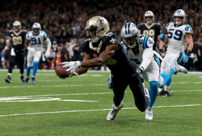 Michael Thomas of the New Orleans Saints catches a pass over James Bradberry #24 of the Carolina Panthers during the first half of the NFC Wild Card playoff game at the Mercedes-Benz Superdome on January 7, 2018 in New Orleans, Louisiana.