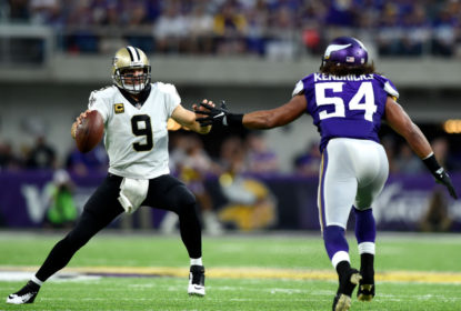MINNEAPOLIS, MN - SEPTEMBER 11: Drew Brees #9 of the New Orleans Saints scrambles with the ball as he is pursued by Eric Kendricks #54 of the Minnesota Vikings in the first half of the game on September 11, 2017 at U.S. Bank Stadium in Minneapolis, Minnesota.