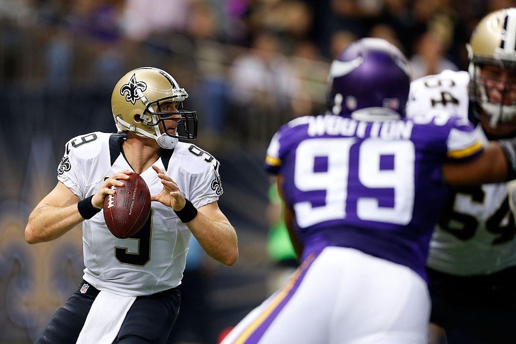 NEW ORLEANS, LA - SEPTEMBER 21: Drew Brees #9 of the New Orleans Saints drops back to pass during the first quarter of a game against the Minnesota Vikings at the Mercedes-Benz Superdome on September 21, 2014 in New Orleans, Louisiana.