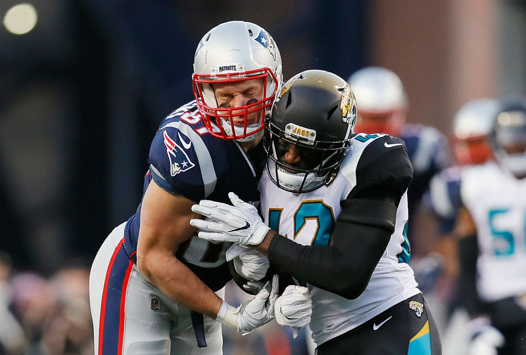 FOXBOROUGH, MA - JANUARY 21: Rob Gronkowski #87 of the New England Patriots is hit by Barry Church #42 of the Jacksonville Jaguars in the second quarter during the AFC Championship Game at Gillette Stadium on January 21, 2018 in Foxborough, Massachusetts.