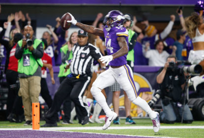 MINNEAPOLIS, MN - JANUARY 14: Stefon Diggs #14 of the Minnesota Vikings scores a touchdown as time expires against the New Orleans Saints during the second half of the NFC Divisional Playoff game at U.S. Bank Stadium on January 14, 2018 in Minneapolis, Minnesota.