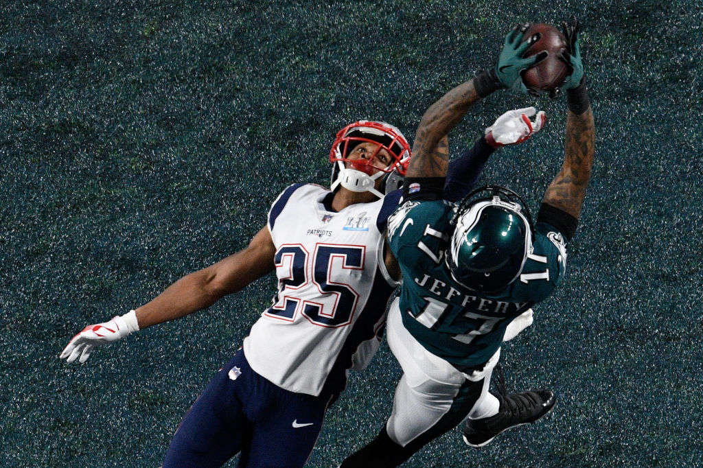 MINNEAPOLIS, MN - FEBRUARY 04: Alshon Jeffery #17 of the Philadelphia Eagles catches a 34 yard pass, over Eric Rowe #25 of the New England Patriots, for a touchdown during the first quarter in Super Bowl LII at U.S. Bank Stadium on February 4, 2018 in Minneapolis, Minnesota. (Photo by Hannah Foslien/Getty