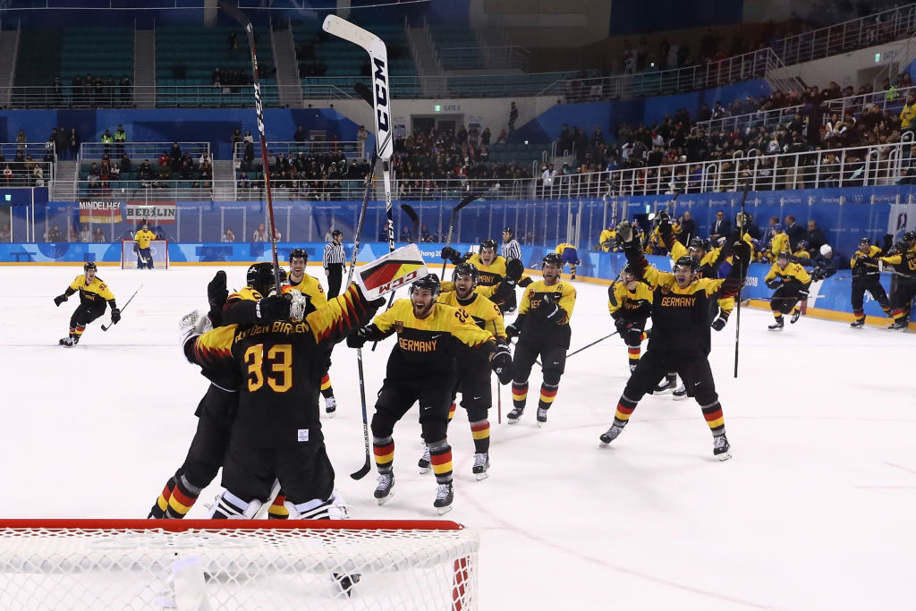 GANGNEUNG, SOUTH KOREA - FEBRUARY 21: Team Germany celebrates after defeating Sweden 4-3 in overtime during the Men's Play-offs Quarterfinals game on day twelve of the PyeongChang 2018 Winter Olympic Games at Kwandong Hockey Centre on February 21, 2018 in Gangneung, South Korea.