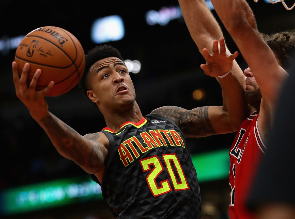 CHICAGO, IL - OCTOBER 26: John Collins #20 of the Atlanta Hawks puts up a shot against Robin Lopez #42 of the Chicago Bulls at the United Center on October 26, 2017 in Chicago, Illinois. The Bulls defeated the Hawks 91-86