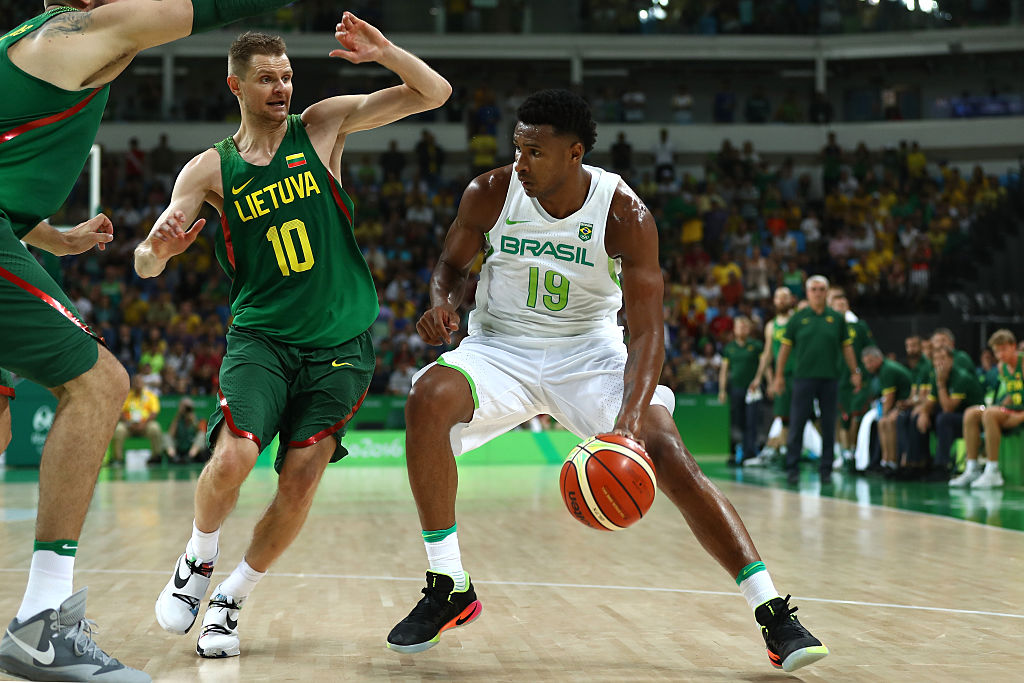 Leandro Barbosa of Brazil drives the ball against Renaldas Seibutis of Lithuania during a Men's preliminary round basketball game between Brazil and Lithuania on Day 2 of the Rio 2016 Olympic Games at Carioca Arena 1 on August 7, 2016 in Rio de Janeiro, Brazil.