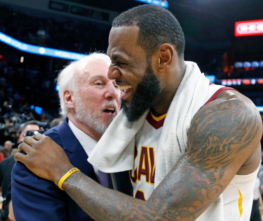 SAN ANTONIO,TX - JANUARY 23 : LeBron James #23 of the Cleveland Cavaliers is congratulated by Gregg Popovich head coach of the San Antonio Spurs at the end of the game at AT&T Center on January 23, 2018 in San Antonio, Texas