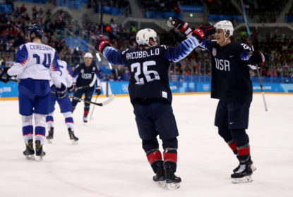 GANGNEUNG, SOUTH KOREA - FEBRUARY 20: Mark Arcobello #26 of the United States celebrates with his teammates after scoring a goal on Jan Laco #50 of Slovakia in the second period during the Men's Play-offs Qualifications game on day eleven of the PyeongChang 2018 Winter Olympic Games at Gangneung Hockey Centre on February 20, 2018 in Gangneung, South Korea.