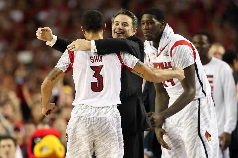 ATLANTA, GA - APRIL 08: (L-R) Peyton Siva #3, head coach Rick Pitino and Montrezl Harrell #24 of the Louisville Cardinals celebrate against the Michigan Wolverines during the 2013 NCAA Men's Final Four Championship at the Georgia Dome on April 8, 2013 in Atlanta, Georgia.