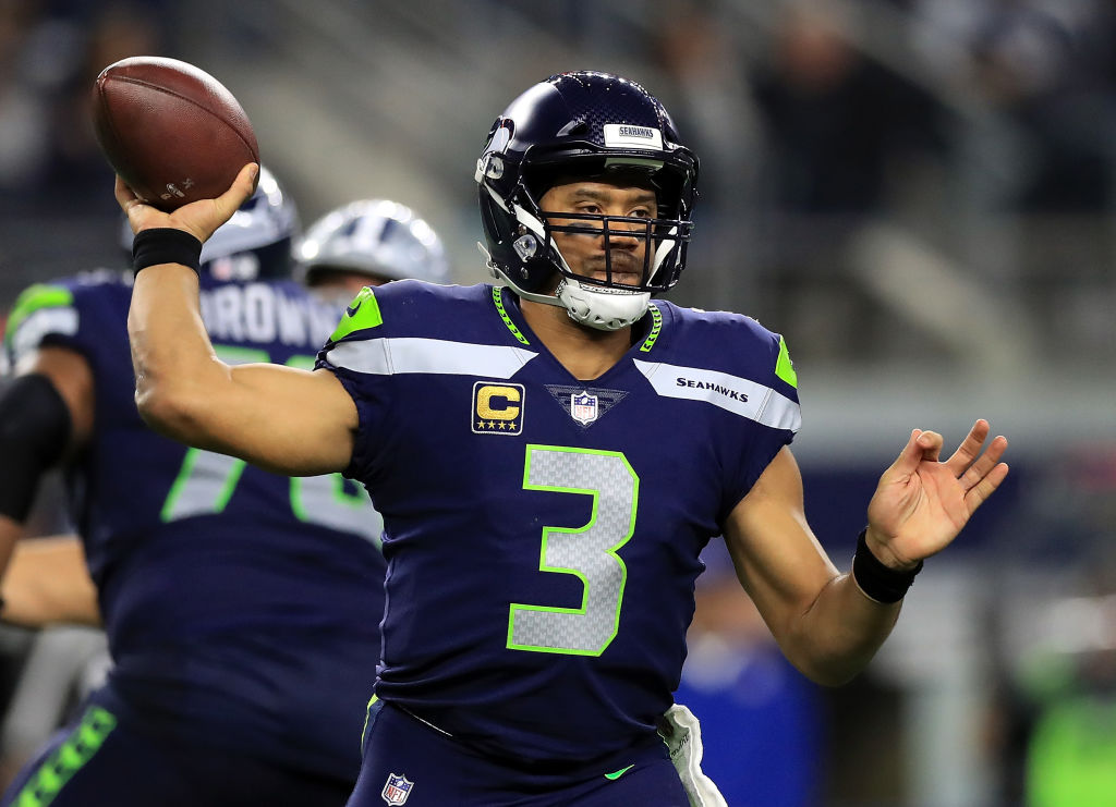 Russell Wilson #3 of the Seattle Seahawks throws against the Dallas Cowboys in the second half at AT&T Stadium on December 24, 2017 in Arlington, Texas
