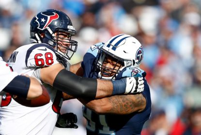 NASHVILLE, TN - DECEMBER 03: Derrick Morgan #91 of the Tennessee Titans fights through Breno Giacomini #68 of the Houston Texans to get to Tom Savage #3 during the first half at Nissan Stadium on December 3, 2017 in Nashville, Tennessee.