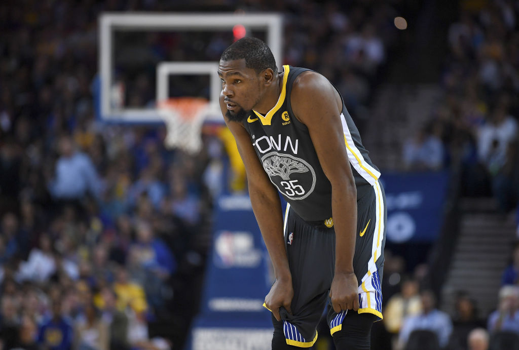OAKLAND, CA - FEBRUARY 06: Kevin Durant #35 of the Golden State Warriors looks on against the Oklahoma City Thunder during their NBA basketball game at ORACLE Arena on February 6, 2018 in Oakland, California