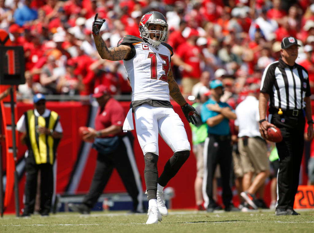 TAMPA, FL - SEPTEMBER 17: Wide receiver Mike Evans #13 of the Tampa Bay Buccaneers celebrates in the end zone after his 13-yard touchdown reception from quarterback Jameis Winston during the first quarter of an NFL football game on September 17, 2017 at Raymond James Stadium in Tampa, Florida.