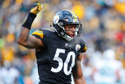 Ryan Shazier #50 of the Pittsburgh Steelers reacts after he intercepted a pass thrown by Matt Moore #8 of the Miami Dolphins in the third quarter during the Wild Card Playoff game against the Miami Dolphins at Heinz Field on January 8, 2017 in Pittsburgh, Pennsylvania.