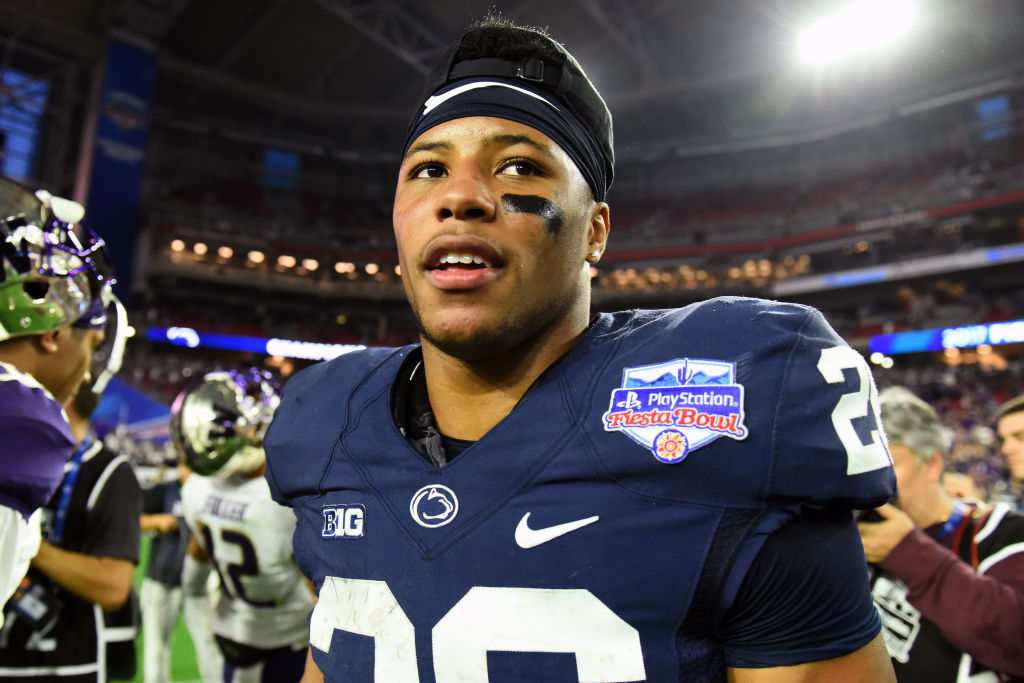 GLENDALE, AZ - DECEMBER 30: Running back Saquon Barkley #26 of the Penn State Nittany Lions reacts on the field after defeating the Washington Huskies 35-28 in the PlayStation Fiesta Bowl at University of Phoenix Stadium on December 30, 2017 in Glendale, Arizona. The Penn State Nittany Lions won 35-28