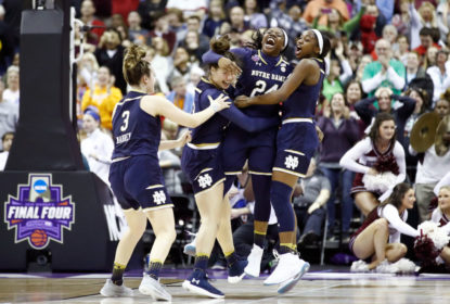 COLUMBUS, OH - APRIL 01: Arike Ogunbowale #24 of the Notre Dame Fighting Irish is congratulated by her teammates Marina Mabrey #3, Kathryn Westbeld #33 and Jackie Young #5 after scoring the game winning basket with 0.1 seconds remaining in the fourth quarter to defeat the Mississippi State Lady Bulldogs in the championship game of the 2018 NCAA Women's Final Four at Nationwide Arena on April 1, 2018 in Columbus, Ohio. The Notre Dame Fighting Irish defeated the Mississippi State Lady Bulldogs 61-58.