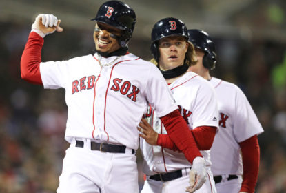 BOSTON, MA - APRIL 10: Mookie Betts #50 of the Boston Red Sox celebrates with Brock Holt #12 after hitting a grand slam during the sixth inning against the New York Yankees at Fenway Park on April 10, 2018 in Boston, Massachusetts.