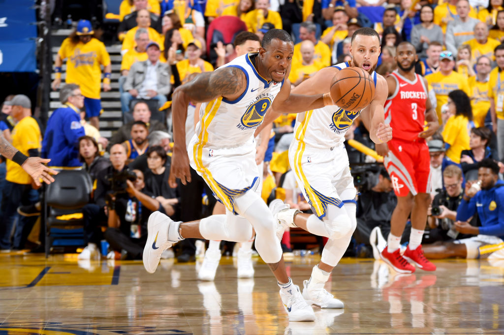 OAKLAND, CA - MAY 20: Andre Iguodala #9 of the Golden State Warriors handles the ball against the Houston Rockets during Game Three of the Western Conference Finals during the 2018 NBA Playoffs on May 20, 2018 at ORACLE Arena in Oakland, California