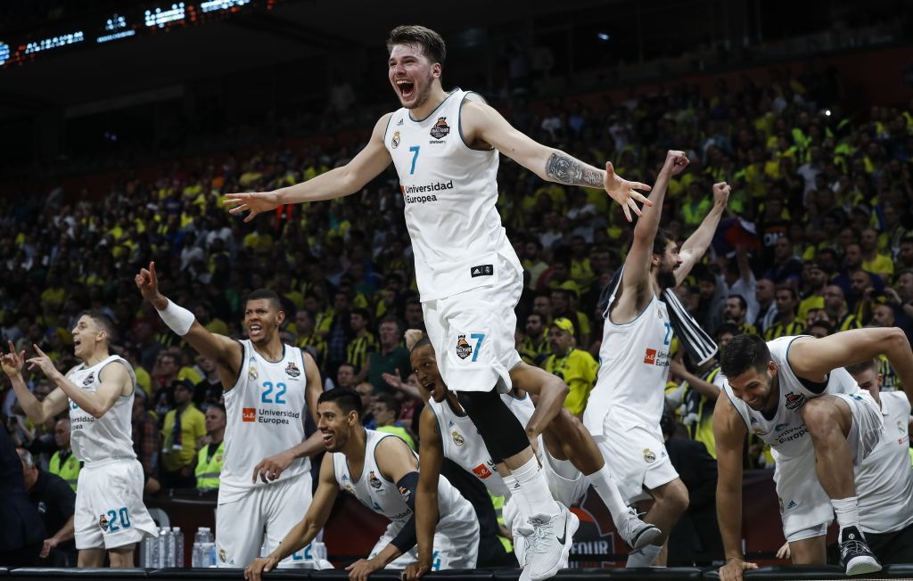 BELGRADE, SERBIA - MAY 20: Luka Doncic (C) of Real Madric celebrates victory after the Turkish Airlines Euroleague Final Four Belgrade 2018 Final match between Real Madrid and Fenerbahce Istanbul Dogus at Stark Arena on May 20, 2018 in Belgrade, Serbia.