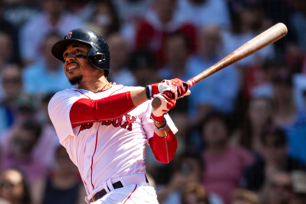 BOSTON, MA - MAY 2: Mookie Betts #50 of the Boston Red Sox hits a solo home run during the fifth inning of a game against the Kansas City Royals on May 2, 2018 at Fenway Park in Boston, Massachusetts. It was his second home run of the game.