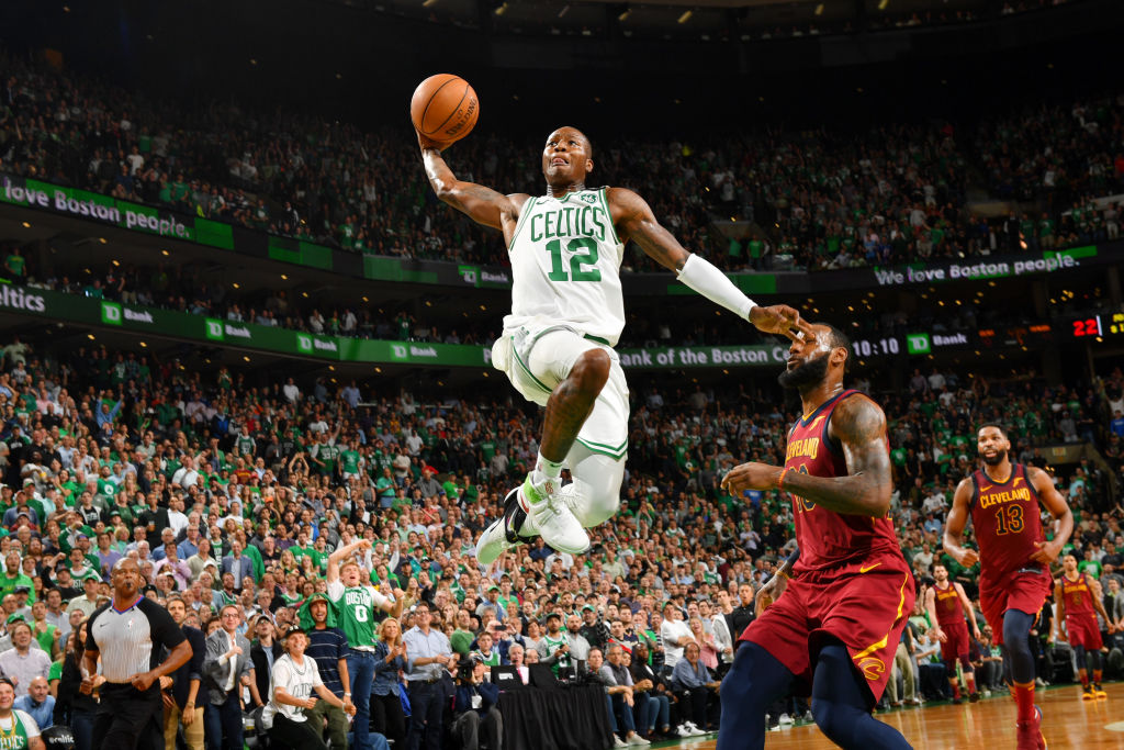 BOSTON, MA - MAY 15: Terry Rozier #12 of the Boston Celtics dunks against the Cleveland Cavaliers during Game Two of the Eastern Conference Finals of the 2018 NBA Playoffs on May 15, 2018 at the TD Garden in Boston, Massachusetts