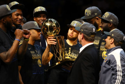 CLEVELAND, OH - JUNE 08: Stephen Curry #30 of the Golden State Warriors celebrates with the Larry O'Brien Trophy after defeating the Cleveland Cavaliers during Game Four of the 2018 NBA Finals at Quicken Loans Arena on June 8, 2018 in Cleveland, Ohio. The Warriors defeated the Cavaliers 108-85 to win the 2018 NBA Finals