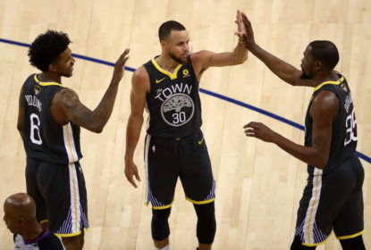 OAKLAND, CA - JUNE 03: Kevin Durant #35 of the Golden State Warriors celerbates with Stephen Curry #30 and Nick Young #6 against the Cleveland Cavaliers during the second quarter in Game 2 of the 2018 NBA Finals at ORACLE Arena on June 3, 2018 in Oakland, California. NOTE TO USER: User expressly acknowledges and agrees that, by downloading and or using this photograph, User is consenting to the terms and conditions of the Getty Images License Agreement.