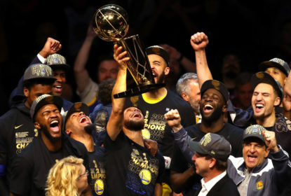 Stephen Curry #30 of the Golden State Warriors celebrates with the Larry O'Brien Trophy after defeating the Cleveland Cavaliers during Game Four of the 2018 NBA Finals