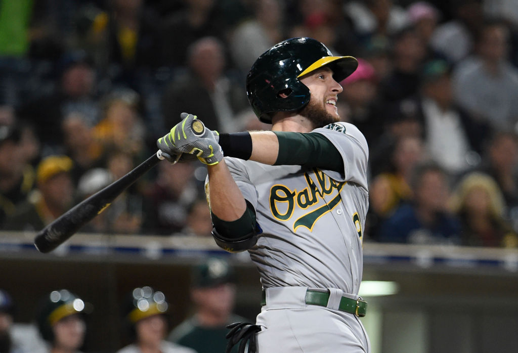 SAN DIEGO, CA - JUNE 19: Jed Lowrie #8 of the Oakland Athletics hits a two-run home run during the tenth inning of a baseball game against the San Diego Padres at PETCO Park on June 19, 2018 in San Diego, California