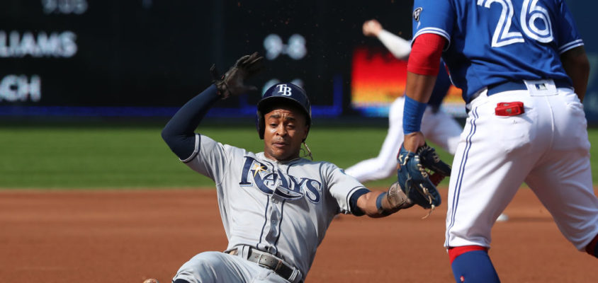 TORONTO, ON - AUGUST 11: Mallex Smith #0 of the Tampa Bay Rays slides into third base safely as he advances from second base on a groundout before scoring a run in the first inning during MLB game action against the Toronto Blue Jays at Rogers Centre on August 11, 2018 in Toronto, Canada
