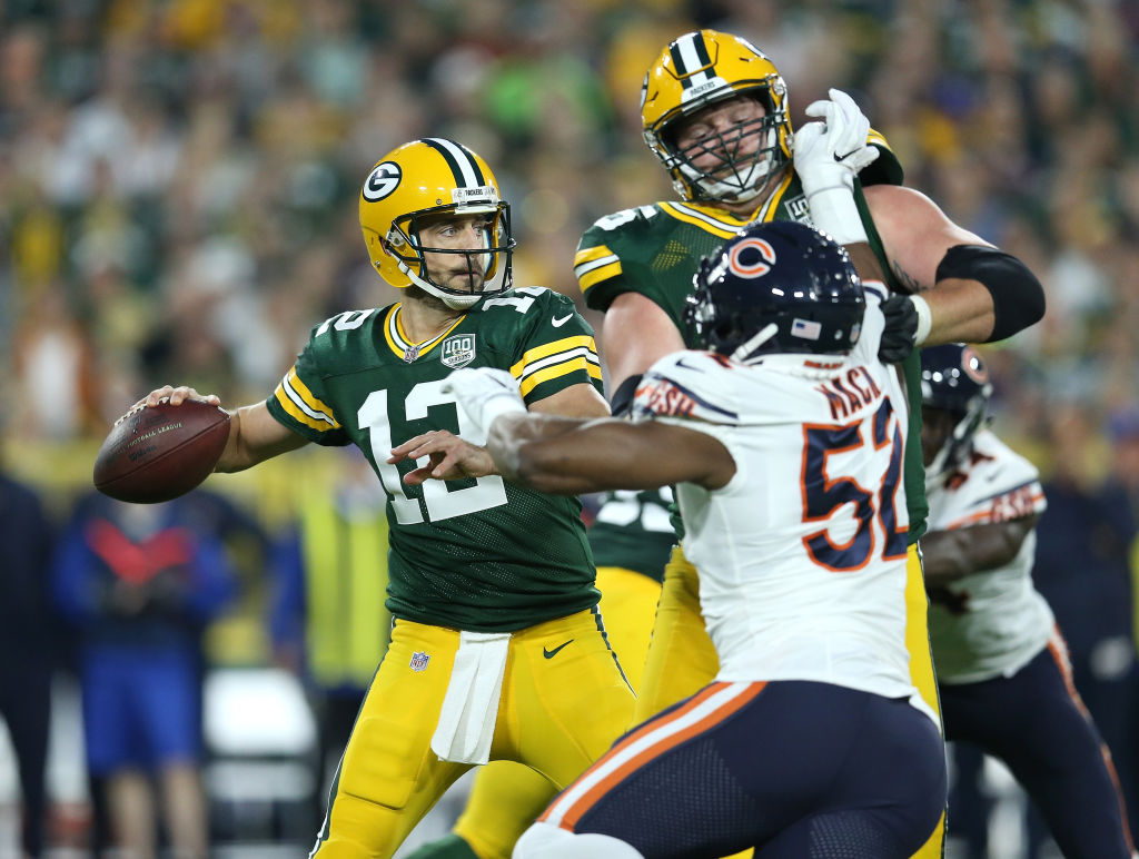 GREEN BAY, WI - SEPTEMBER 09: Aaron Rodgers #12 of the Green Bay Packers throws during the first quarter of a game against the Chicago Bears at Lambeau Field on September 9, 2018 in Green Bay, Wisconsin