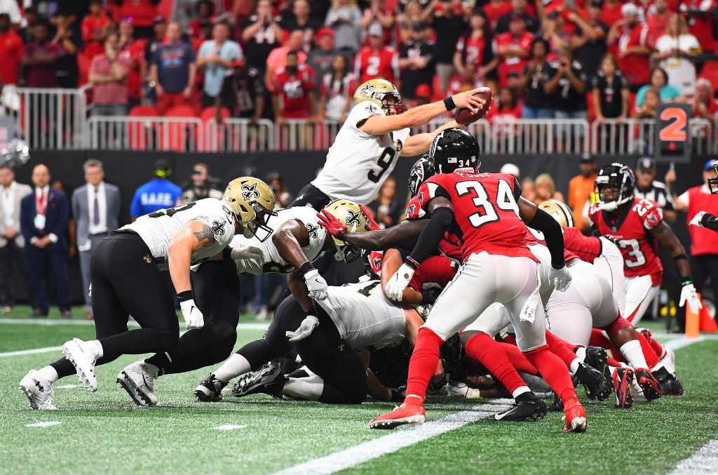 ATLANTA, GA - SEPTEMBER 23: Drew Brees #9 of the New Orleans Saints scores the game-winning touchdown in overtime against the Atlanta Falcons at Mercedes-Benz Stadium on September 23, 2018 in Atlanta, Georgia