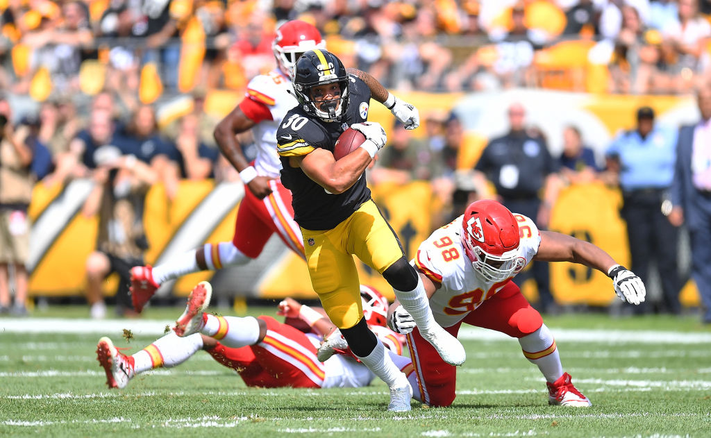 PITTSBURGH, PA - SEPTEMBER 16: James Conner #30 of the Pittsburgh Steelers runs the ball in the first half during the game against the Kansas City Chiefs at Heinz Field on September 16, 2018 in Pittsburgh, Pennsylvania