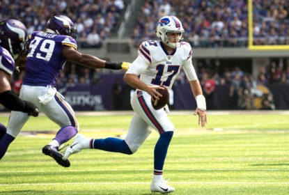 MINNEAPOLIS, MN - SEPTEMBER 23: Josh Allen #17 of the Buffalo Bills runs with the ball before diving for a touchdown in the first quarter of the game against the Minnesota Vikings at U.S. Bank Stadium on September 23, 2018 in Minneapolis, Minnesota