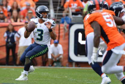 DENVER, CO - SEPTEMBER 9: Quarterback Russell Wilson #3 of the Seattle Seahawks drops back for a pass against the Seattle Seahawks at Broncos Stadium at Mile High