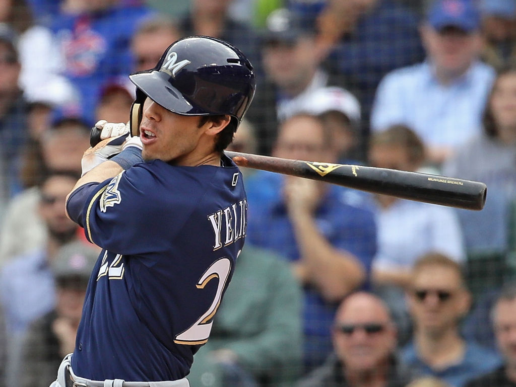 CHICAGO, IL - OCTOBER 01: Christian Yelich #22 of the Milwaukee Brewers hits a run scoring single in the 3rd inning against the Chicago Cubs during the National League Tiebreaker Game at Wrigley Field on October 1, 2018 in Chicago, Illinois