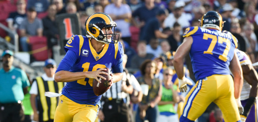 LOS ANGELES, CA - SEPTEMBER 27: Quarterback Jared Goff #16 of the Los Angeles Rams rushes out of the pocket against the Minnesota Vikings at Los Angeles Memorial Coliseum on September 27, 2018 in Los Angeles, California