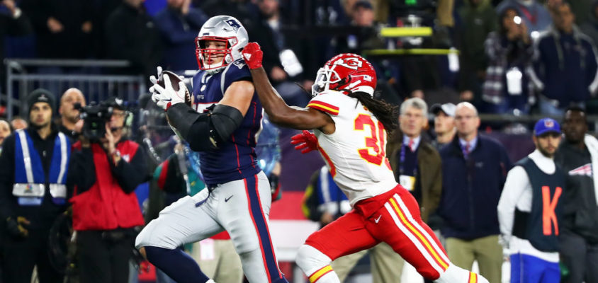 FOXBOROUGH, MA - OCTOBER 14: Rob Gronkowski #87 of the New England Patriots makes a catch while under pressure from Josh Shaw #30 of the Kansas City Chiefs in the fourth quarter of a game at Gillette Stadium on October 14, 2018 in Foxborough, Massachusetts