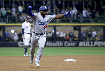 MILWAUKEE, WI - OCTOBER 20: Yasiel Puig #66 of the Los Angeles Dodgers celebrates after hitting a three run home run against Jeremy Jeffress #32 of the Milwaukee Brewers during the sixth inning in Game Seven of the National League Championship Series at Miller Park on October 20, 2018 in Milwaukee, Wisconsin