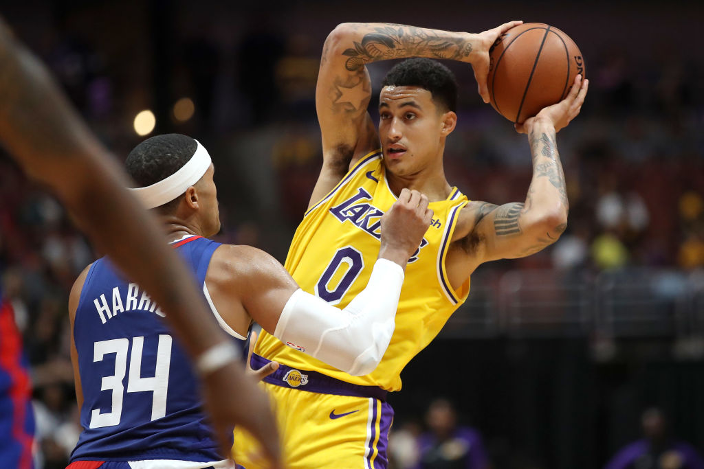 ANAHEIM, CA - OCTOBER 06: Tobias Harris #34 of the LA Clippers defends against Kyle Kuzma #0 of the Los Angeles Lakers during the second half of a NBA preseason game at Honda Center on October 6, 2018 in Anaheim, California