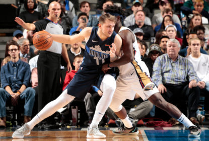 DALLAS, TX - DECEMBER 26: Luka Doncic #77 of the Dallas Mavericks fights for position against the New Orleans Pelicans on December 26, 2018 at the American Airlines Center in Dallas, Texas