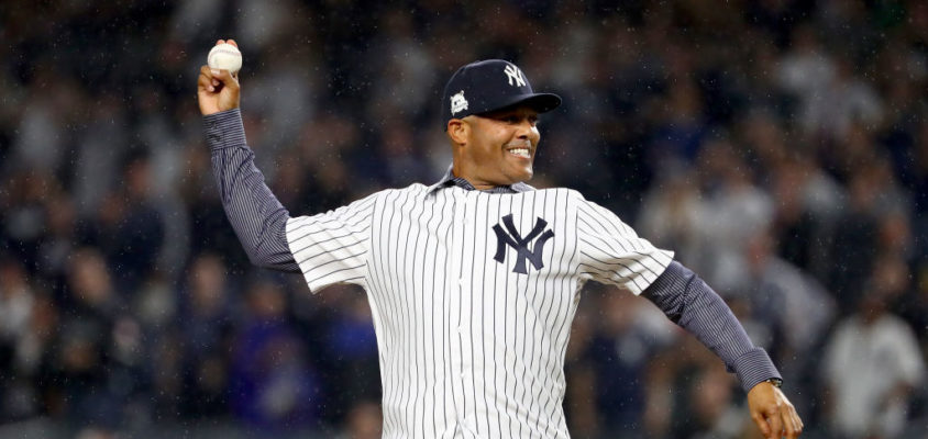NEW YORK, NY - OCTOBER 09: Former pitcher Mariano Rivera throws out the ceremonial first pitch prior to Game Four of the American League Divisional Series between the Cleveland Indians and the New York Yankees at Yankee Stadium on October 9, 2017 in the Bronx borough of New York City