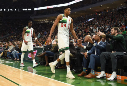 MILWAUKEE, WISCONSIN - DECEMBER 29: Tony Snell #21 and Giannis Antetokounmpo #34 of the Milwaukee Bucks walk to the bench during a game against the Brooklyn Nets at Fiserv Forum on December 29, 2018 in Milwaukee, Wisconsin
