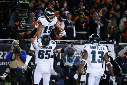 CHICAGO, ILLINOIS - JANUARY 06: Golden Tate #19 celebrates with Lane Johnson #65 of the Philadelphia Eagles after scoring a touchdown against the Chicago Bears in the fourth quarter of the NFC Wild Card Playoff game at Soldier Field on January 06, 2019 in Chicago, Illinois