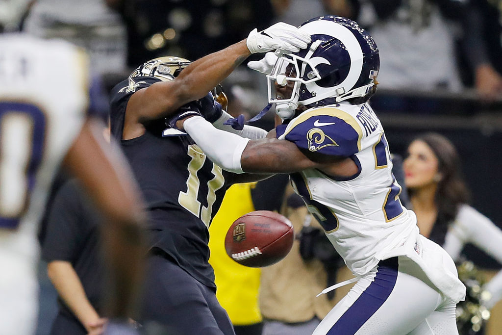 NEW ORLEANS, LOUISIANA - JANUARY 20: Tommylee Lewis #11 of the New Orleans Saints drops a pass broken up by Nickell Robey-Coleman #23 of the Los Angeles Rams during the fourth quarter in the NFC Championship game at the Mercedes-Benz Superdome on January 20, 2019 in New Orleans, Louisiana