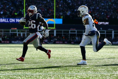 FOXBOROUGH, MASSACHUSETTS - JANUARY 13: Sony Michel #26 of the New England Patriots carries the ball during the first quarter in the AFC Divisional Playoff Game against the Los Angeles Chargers at Gillette Stadium on January 13, 2019 in Foxborough, Massachusetts
