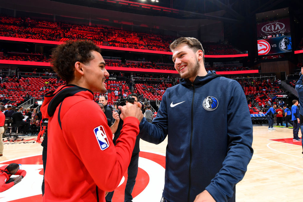 ATLANTA, GA - OCTOBER 24: Trae Young #11 of the Atlanta Hawks and Luka Doncic #77 of the Dallas Mavericks talk before the game on October 24, 2018 at State Farm Arena in Atlanta, Georgia